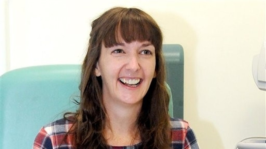 In this Saturday, Jan. 1, 2015 file photo, Pauline Cafferkey, a nurse who contracted Ebola while working in Sierra Leone, smiles in the Royal Free Hospital in London. (Lisa Ferguson/Scotland on Sunday/PA via AP)