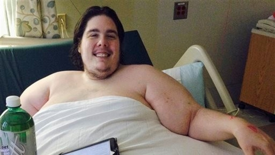 In this Monday, Oct. 12, 2015 photo, Steven Assanti, 33, rests in bed at Kent Hospital in Warwick, R.I. (AP Photo/Jennifer McDermott)