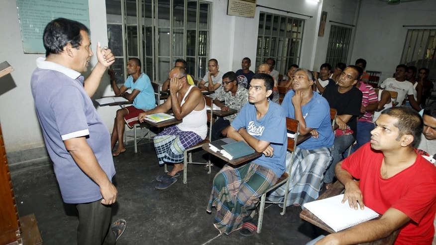 A councillor (L) talks to drug addicts in a classroom at the Bangladesh Rehabilitation and Assistance Centre for Addicts (BARACA) in Dhaka September 12, 2015. REUTERS/Ashikur Rahman