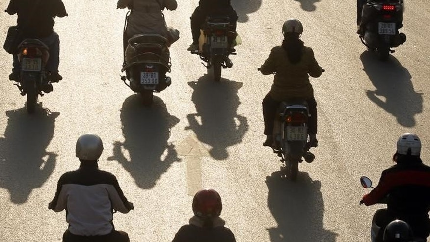 Motorcyclists ride on a street in Hanoi December 18, 2014. REUTERS/Kham