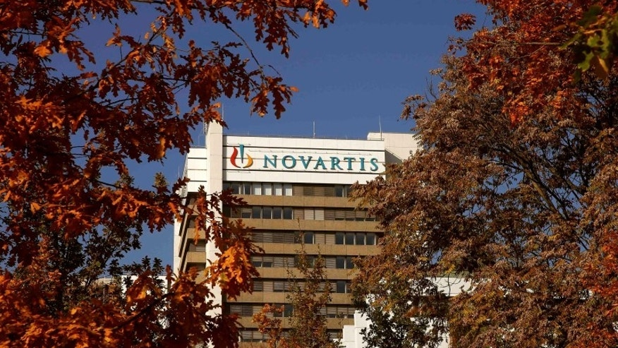 The logo of Swiss pharmaceutical company Novartis is seen on its headquarters building in Basel, Switzerland October 27, 2015.  REUTERS/Arnd Wiegmann