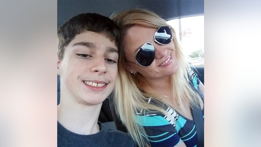 Alex Hoover poses for a photo with his mother, Rene. Alex has a terminal heart condition and has not returned to school because of what his mother says is a dispute over how he might die.
