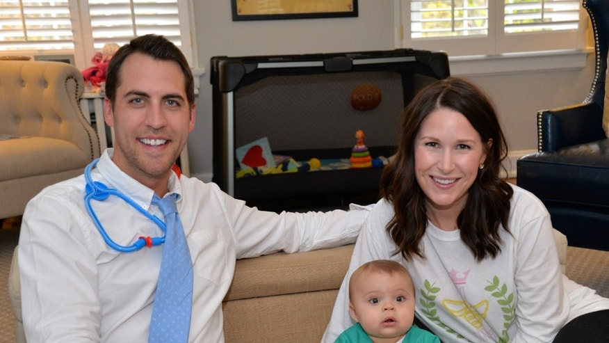 Bea dressed as her liver surgeon, Dr. Maria Alonso for Halloween, with her father, Jordan Weidner, and mother, Hillary Weidner.