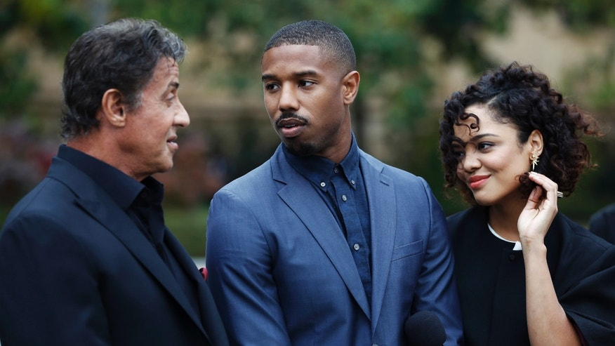 "Sylvester Stallone, from left, Michael B. Jordan and Tessa Thompson talk before a press conference promoting their film ""Creed"" outside the Philadelphia Museum of Art, Friday, Nov. 6, 2015, in Philadelphia. (AP Photo/Matt Slocum)"