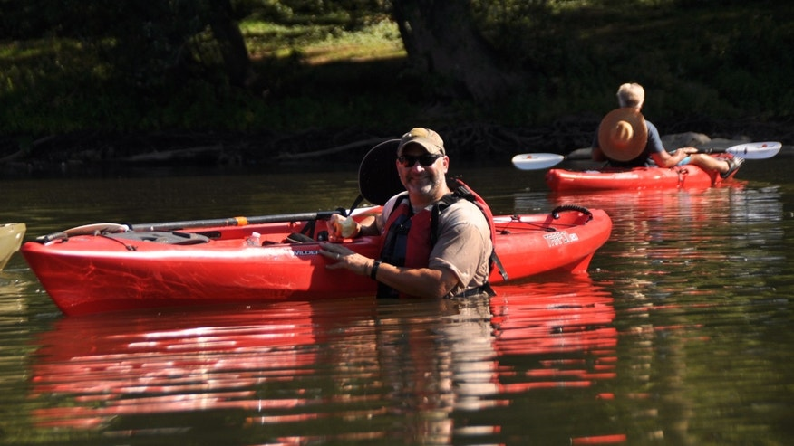 Andy Kaufmann, a participant in Boulder Crest's Warrior PATHH program, poses for a photo while kayaking.