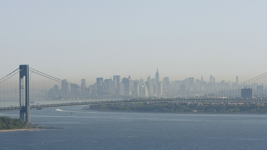 A layer of smog can be seen above Manhattan through the Verrazano-Narrows Bridge in New York.