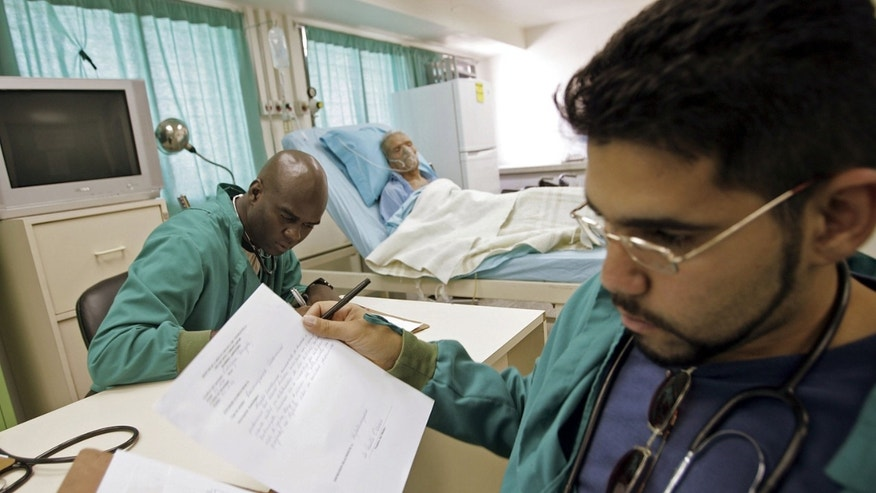 "CARACAS, VENEZUELA - NOVEMBER 28:  Cuban doctors work in a free health care clinic named ""Mission Inside the Barrio"" November 28, 2006 in Caracas, Venezuela. President Hugo Chavez is widely popular in the poor barrios of Caracas due to his socialist efforts to assist the impoverished with missions offering free health care with doctors from Cuba as well as other services. Chavez faces off against challenger Manuel Rosales in the December 3 presidential elections.  (Photo by Mario Tama/Getty Images)"