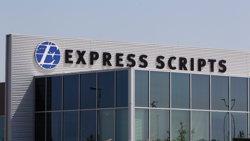 FILE - This July 21, 2011, file photo, shows a building on the Express Scripts campus in Berkeley, Mo. Express Scripts Holding Co. said Tuesday, Dec. 1, 2015, that it will make a treatment for the rare infection toxoplasmosis that costs $1 per pill available on its biggest formulary, or list of covered drugs, as an alternative to Daraprim, which is manufactured by Turing Pharmaceuticals and costs $750 per pill. (AP Photo/Jeff Roberson, File)