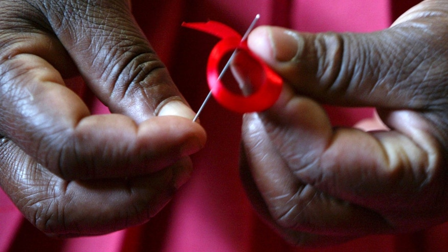 A Kenyan woman prepares ribbons ahead of December 1st, the World Aids Day at Beacon of Hope centre in Nairobi. (REUTERS/Antony Njuguna/Files)