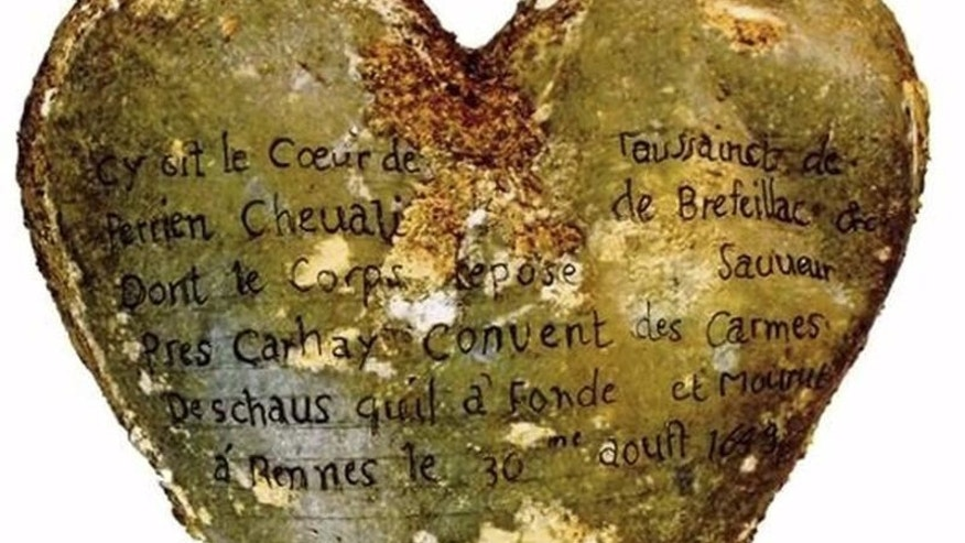 A heart-shaped lead urn with an inscription identifying the contents as the heart of Toussaint Perrien, Knight of Brefeillac, found during excavation of the ruins of the medieval Jacobins convent in Rennes, France is shown in this handout photo provided by Rozenn Colleter on December 2, 2015. REUTERS/Rozenn Colleter/Ph.D./INRAP/Handout via Reuters