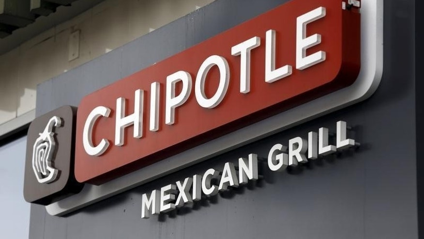 A sign is seen at a Chipotle Mexican Grill restaurant in San Francisco, California July 21, 2015.  REUTERS/Robert Galbraith