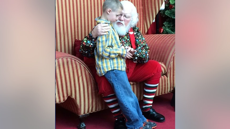 autistic boy with santa