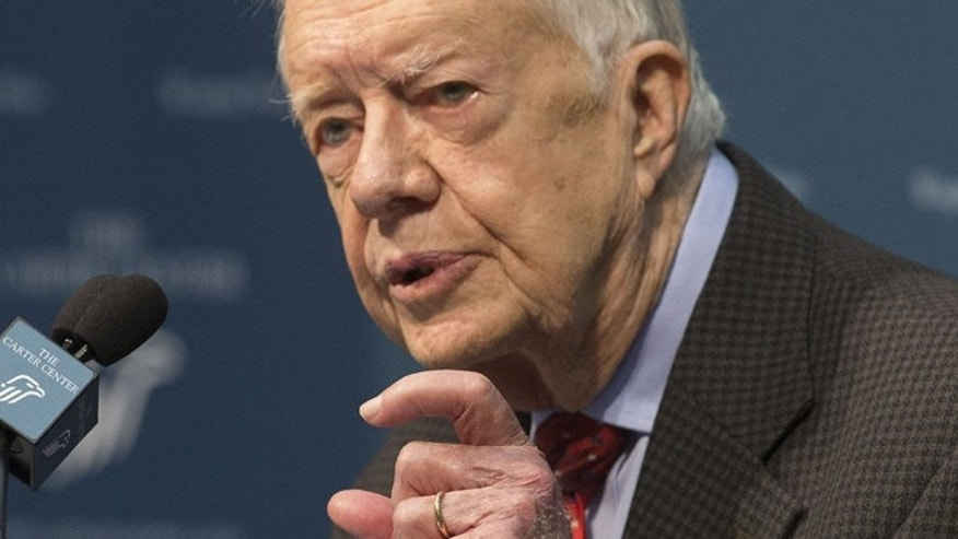 Aug. 20, 2015: Former President Jimmy Carter talks about his cancer diagnosis during a news conference at The Carter Center in Atlanta.