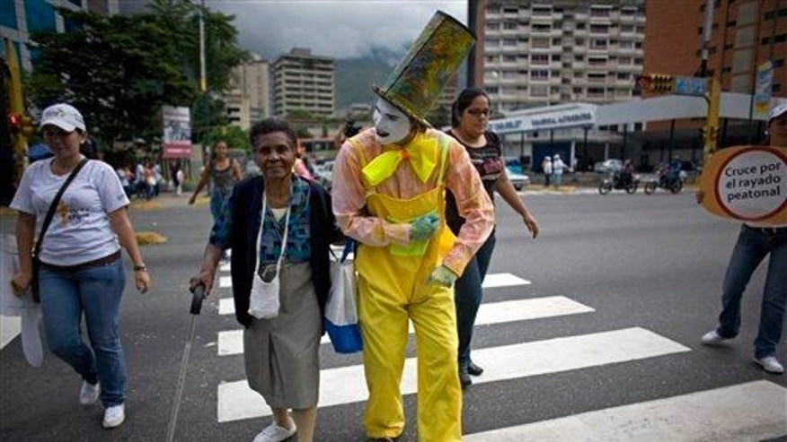 A mime helps a woman cross a street in Caracas, Venezuela. A new study shows small acts of kindness can improve our mental wellbeing and help us deal with stress.