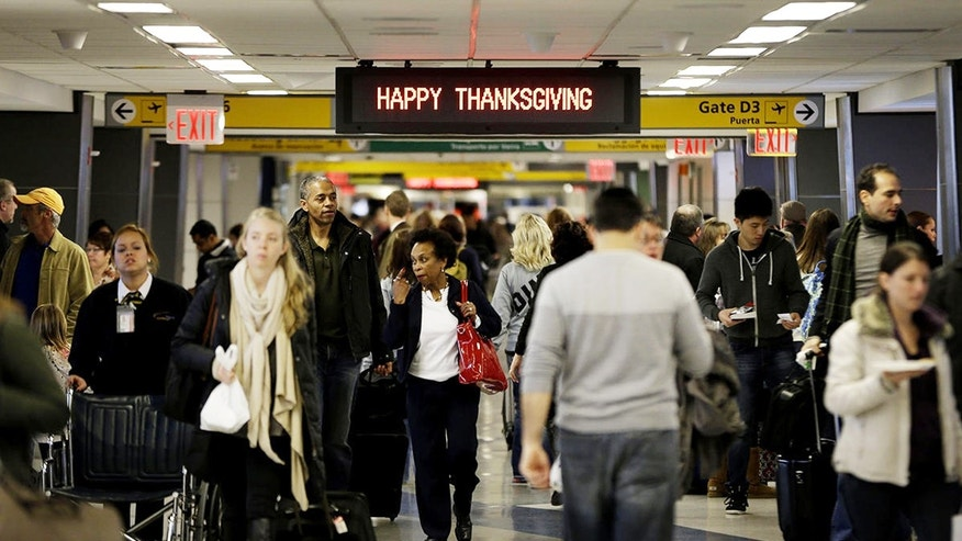 Travelers walk to their gates at LaGuardia Airport in New York ahead of the long Thanksgiving holiday weekend in 2013.
