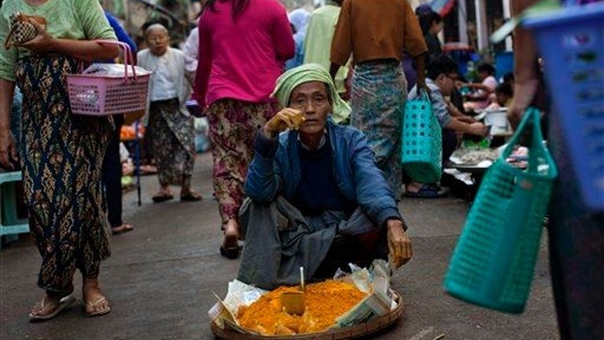 A street vendor sells turmeric powder at a street market in Yangon, Myanmar.