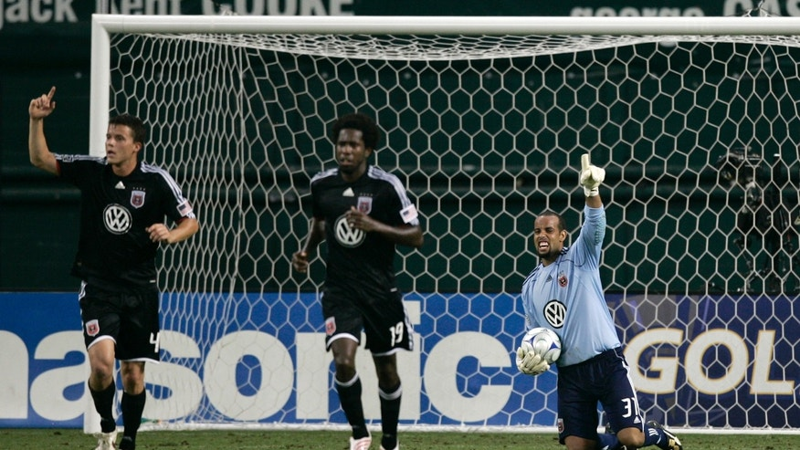 DC United's goalie Josh Wicks (R) gestures after making a save with teammates Marc Burch (L) and Clyde Simms (C) during their MLS soccer match against Chicago Fire in Washington June 13, 2009. REUTERS/Hyungwon Kang   (UNITED STATES SPORT SOCCER) - RTR24N13