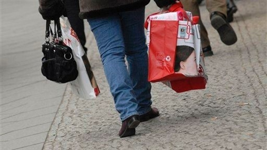 A woman carries shopping bags in Berlin, Germany.
