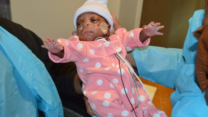 E'layah Faith, pictured here, has defied the odds to celebrate her three-month birthday after being born extremely premature.