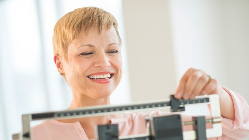woman_scale_happy_weight_loss_istock