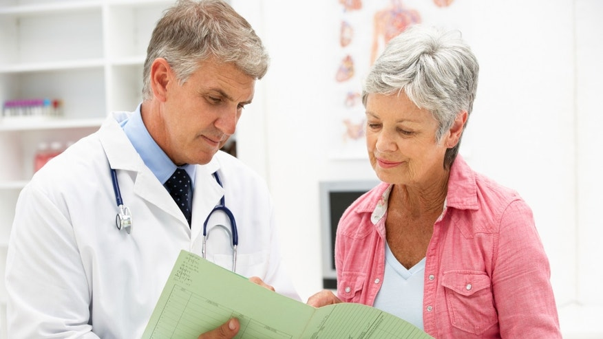 doctor_male_older_female_patient_istock