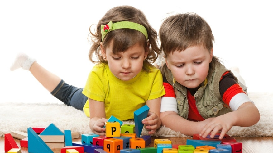 children_playing_blocks_istock