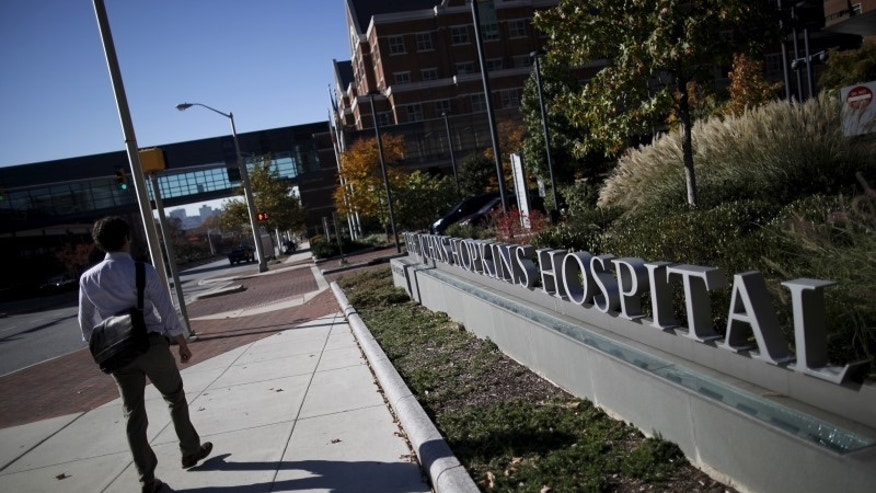 A man walks by the John Hopkins Hospital in Baltimore, Maryland November 4, 2015.  REUTERS/Carlos Barria