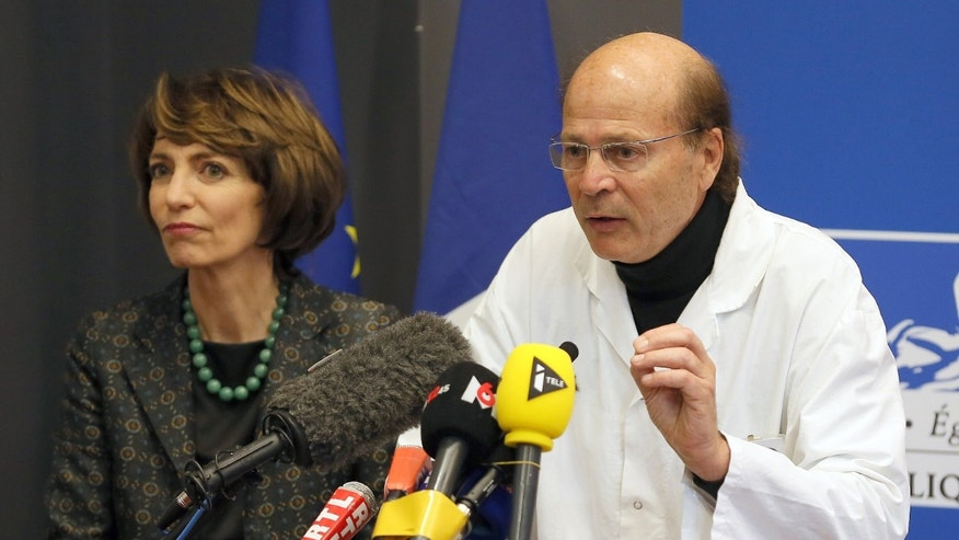 French Health Minister Marisol Touraine, left, and Professor Gilles Edan, the chief neuroscientist at Rennes Hospital, address the media during a press conference.