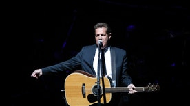 """FILE - In this June 30, 2009, file photo, Glenn Frey, of the the Eagles, performs at Belfast's Odyssey Arena in Northern Ireland. Frey, who co-founded the Eagles and with Don Henley became one of history's most successful songwriting teams with such hits as """"Hotel California"""" and """"Life in the Fast Lane,"""" has died at age 67. He died Monday, Jan. 18, 2016, in New York. (AP Photo/Peter Morrison, File)"""