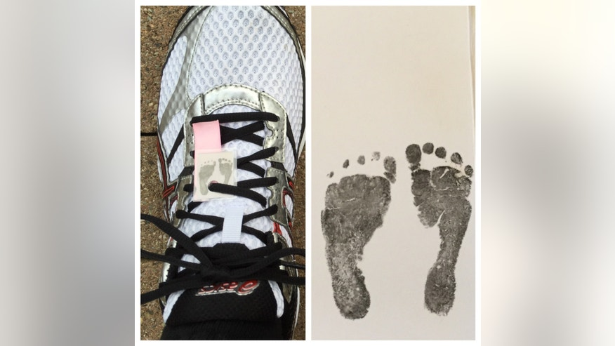 Longo runs with a copy of Angelina's footprints and a pink ribbon. (image courtesy Longo)