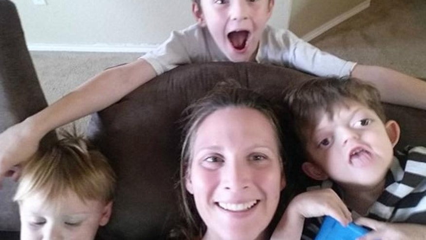AliceAnn Meyer, with her son, Jameson, right, who suffers from Pfieffer syndrome. Meyer blasted Internet trolls who turned her son's picture into an Internet meme.