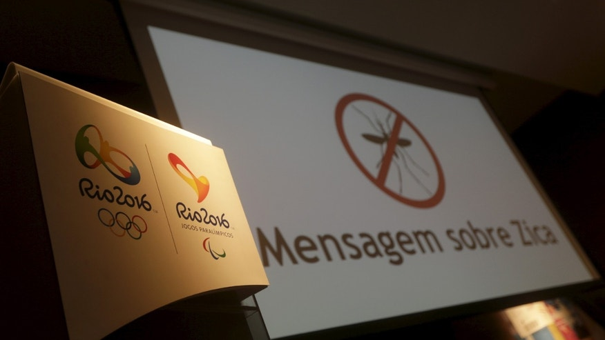 "Feb. 2, 2015: The logos of the Rio 2016 Olympic Games and Rio 2016 Paralympic Games are pictured next to a message on a screen that reads ""Message about Zika"" during a media briefing in Rio de Janeiro, Brazil."