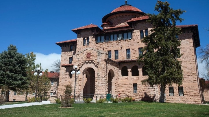 This photo taken April 13, 2015, shows exterior of the grand rotunda entry to the historic Black Hills VA in Hot Springs, S.D. The 108-year-old veteran's hospital built of thick blocks of pink sandstone and topped with red, tiled roofs in a Spanish mission-style overlooks the tiny town of Hot Springs, a scenic escape that's become a haven known for healing veterans over the last century. (AP Photo/Kristina Barker)