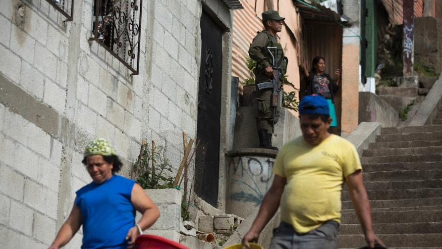 Residents carry empty water buckets in Guatemala City on Feb. 5, 2016.