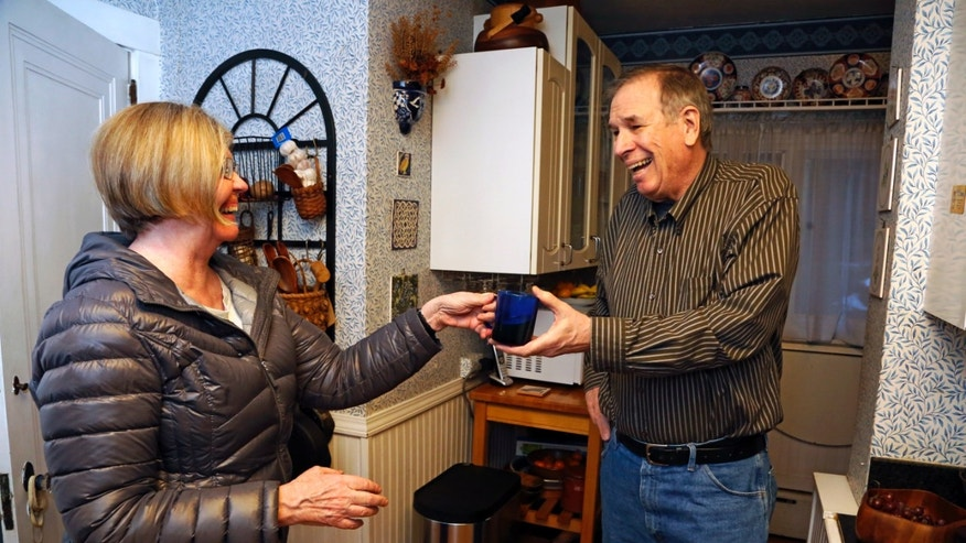 "Dave Bostick and wife Carol share a laugh in the kitchen of their home in Pittsburgh, Tuesday, Feb. 16, 2016. Bostick, 71, a retired vocational rehab counselor, said his low mood and energy level improved ""a little bit"" during a testosterone treatment study but suddenly worsened afterward. He said he has resumed using testosterone at his doctor's recommendation and isn't overly concerned about the potential risks. Something's going to get me sooner or later,"" Bostick said. (AP Photo/Gene J. Puskar)"