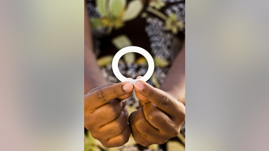 This photo provided by the International Partnership for Microbicides shows a ring that is coated with an anti-AIDS drug designed for women to insert into the vagina once a month to reduce the risk of HIV infection. Researchers say women who inserted a vaginal ring coated with an anti-AIDS drug once a month were partially protected against HIV infection. Two large studies in Africa found the effect was modest, reducing overall HIV infection by about a third. But surprisingly, the ring worked far better in women 25 and older, leaving researchers wondering if younger women who got little to no benefit simply didn't use the device properly. (Andrew Loxley/International Partnership for Microbicides via AP)