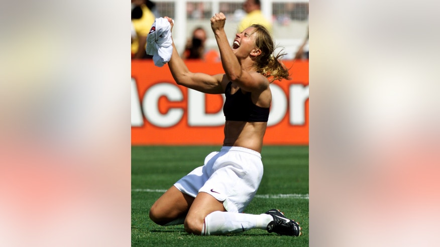 July 10, 1999: United States midfielder Brandi Chastain celebrates her winning penalty kick to defeat China 5-4 at the Women's World Cup soccer final between the two countries at the Rose Bowl.