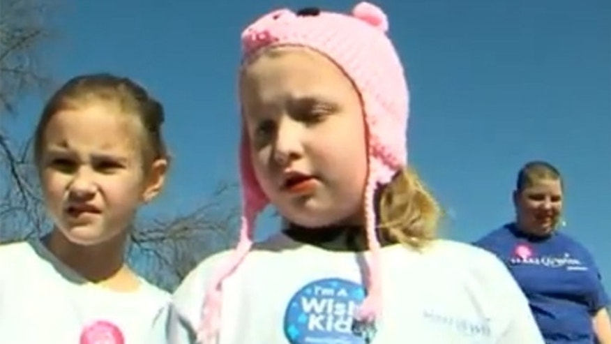 Amelia Meyer, center, used her Make-A-Wish to clean up her local park.