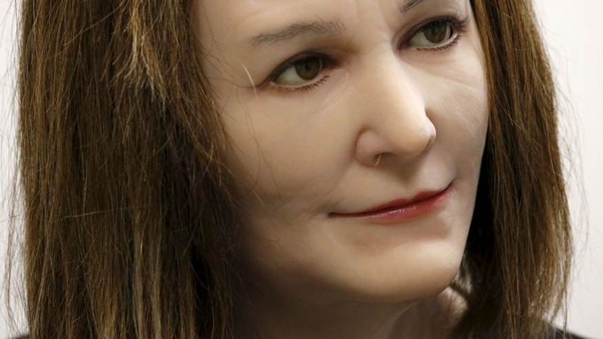 A humanoid created by NTU Professor Thalmann and her team, listens during an interview with Reuters in Singapore