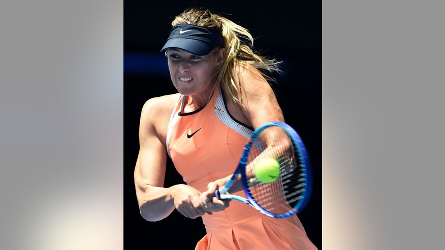 FILE - In this Tuesday, Jan.  26, 2016, file photo, Maria Sharapova of Russia plays a backhand return to Serena Williams of the United States during their quarterfinal match at the Australian Open tennis championships in Melbourne, Australia. The five-time major champion says she failed a doping test at the Australian Open in January for the little-known drug, which became a banned substance under the WADA code this year. The former world No. 1 took full responsibility for her mistake when she made the announcement at a news conference Monday in Los Angeles. (AP Photo/Andrew Brownbill, File)