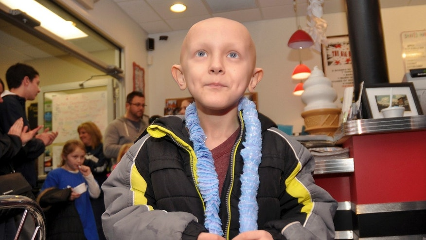 In this Jan. 10, 2016 photo, Dorian Murray looks up to applause and cheers at a community birthday party for him at Mel's Downtown Creamery in Pawcatuck, Conn. He had turned 8 on Jan. 5. Murray, of Westerly, R.I., died Tuesday, March 8, 2016, of a rare and untreatable form of pediatric cancer. He had told his father that his final wish was to become famous in China. (Christine Corrigan/The Westerly Sun via AP) MANDATORY CREDIT.