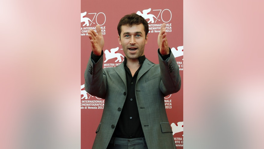 "FILE - In this Aug. 30, 2013 file photo, actor James Deen poses at photo call for the film ""The Canyons"" at the Venice Film Festival in Venice, Italy. California has cited a movie company owned by porn star Deen, whose real name is Bryan Sevilla, for failing to use condoms on a film shoot, potentially exposing actors to hepatitis B and HIV. The state Division of Occupational Safety and Health (Cal/OSHA) on Wednesday, March 9, 2016 cited Los Angeles-based Third Rock Productions for nine violations, some considered serious, and proposed nearly $78,000 in fines. (AP Photo/David Azia, File)"