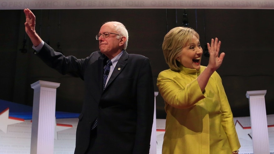 Democratic U.S. presidential candidates Senator Bernie Sanders and former Secretary of State Hillary Clinton arrive on stage ahead of the start of the PBS NewsHour Democratic presidential candidates debate in Milwaukee, Wisconsin, February 11, 2016. REUTERS/Darren Hauck - RTX26KPE