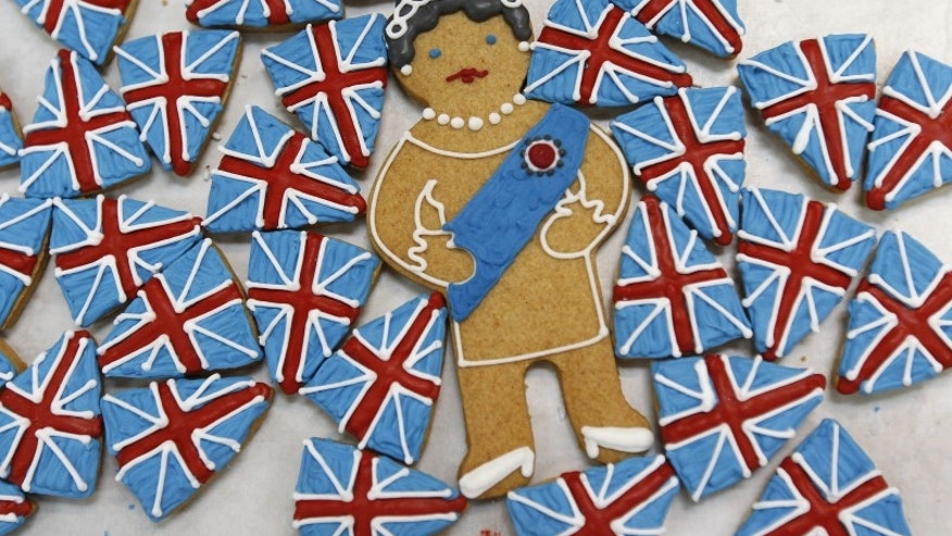 File photo of biscuits depicting Britain's Queen Elizabeth and the Union flag sitting on trays at Biscuiteers in London