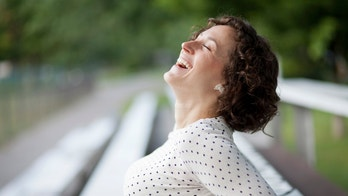 happy_woman_laughing_istock