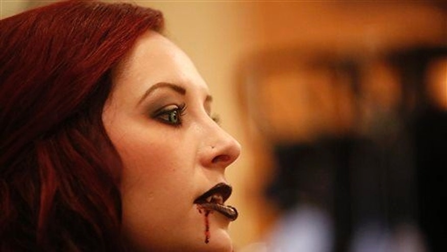 A woman is dressed as a vampire in this file photo.