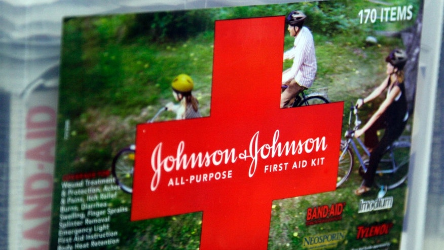 A first aid kit made by Johnson & Johnson for sale on a store shelf in Westminster, Colorado April 14, 2009. Johnson & Johnson said its quarterly earnings fell, hurt by generic competition for its Risperdal schizophrenia drug and the strong dollar, but lower costs enabled the company to beat Wall Street expectations.    REUTERS/Rick Wilking (UNITED STATES BUSINESS) - RTXDZJN