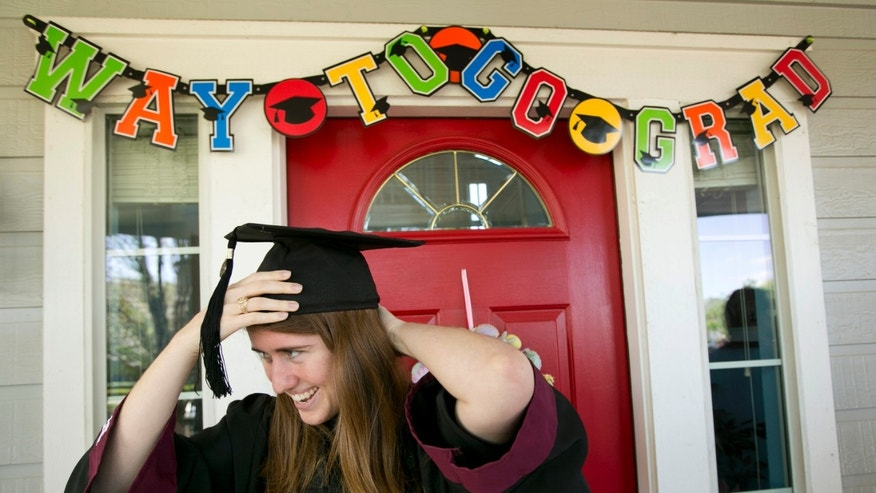 Jenny Brewer gets ready for her graduation ceremony at her home in Circle C Ranch Tuesday March 22, 2016 in Austin, Texas.