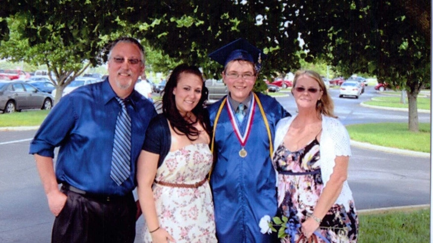 Jacob with his family at high school graduation.