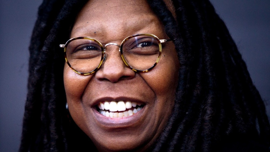 """TV personality Whoopi Goldberg arrives for the premiere of """"The Imitation Game"""" in New York, November 17, 2014.        REUTERS/Carlo Allegri (UNITED STATES - Tags: ENTERTAINMENT) - RTR4EI9T"""